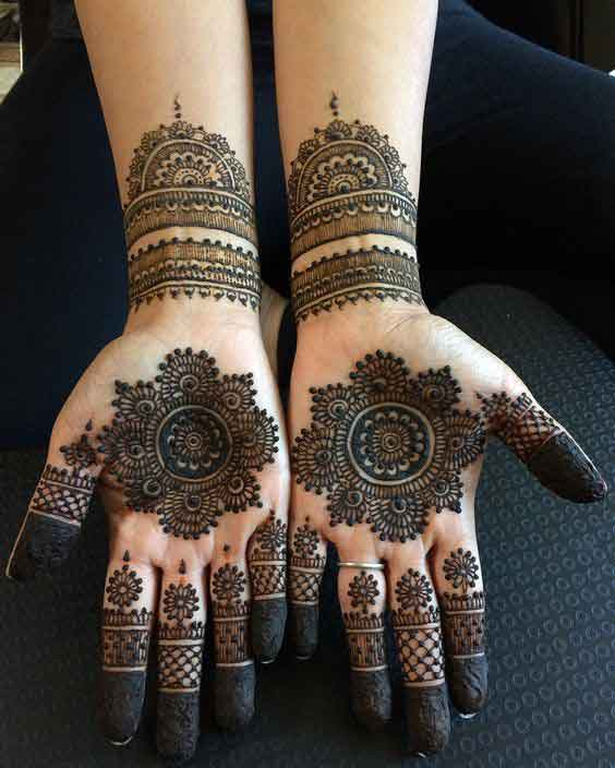 Rounded mehndi designs on palms and front hands