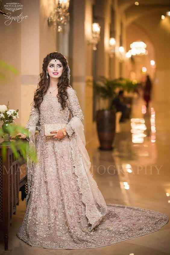 Beautiful pink long frock for Pakistani engagement bride