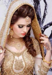 Perfect engagement makeup with golden dress