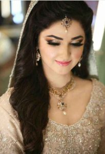 Pakistani engagement makeup with off white bridal dress