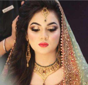 Latest Pakistani engagement makeup with light green and golden dress
