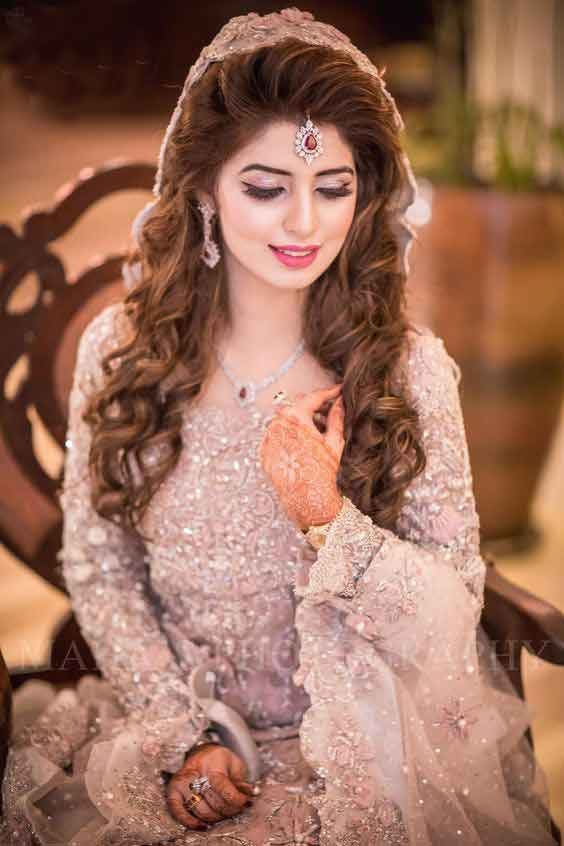 Latest Pakistani bridal makeup with pink dress
