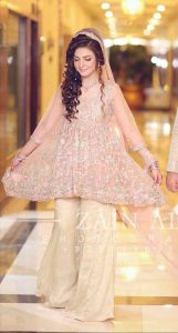Pink short frock with off white sharara for engagement