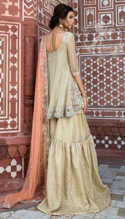 Off white short frock with peach dupatta for engagement