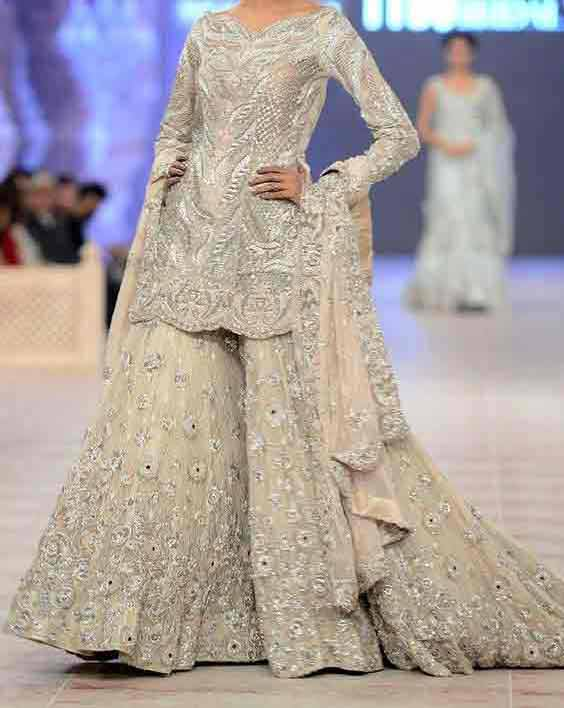 Silver short shirt with sharara ans dupatta for engagement