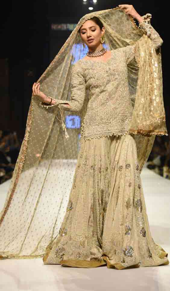 Latest golden shirt with sharara for Pakistani engagement brides