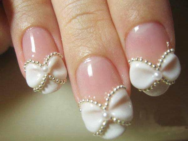 Cute white bow with pearls nail art for Pakistani engagement