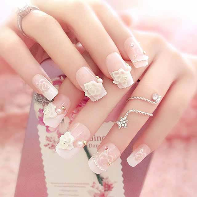 Latest white floral nail art with pearls for engagement