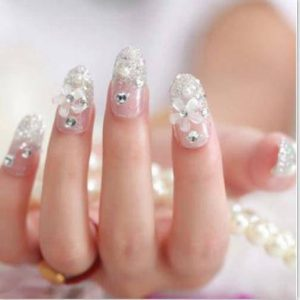 Latest pearls nail art designs for engagement