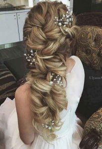 Latest Twisted waves hairstyle with accessories for brides