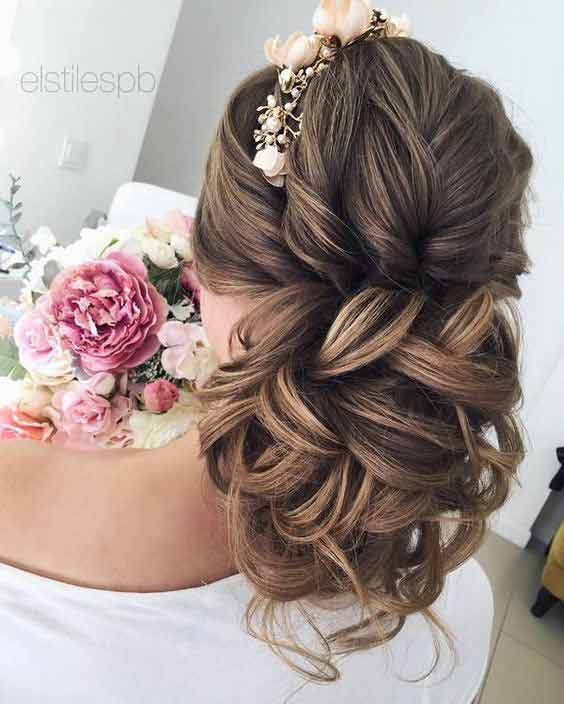Twisted hair bun with flowers hairstyle for engagement