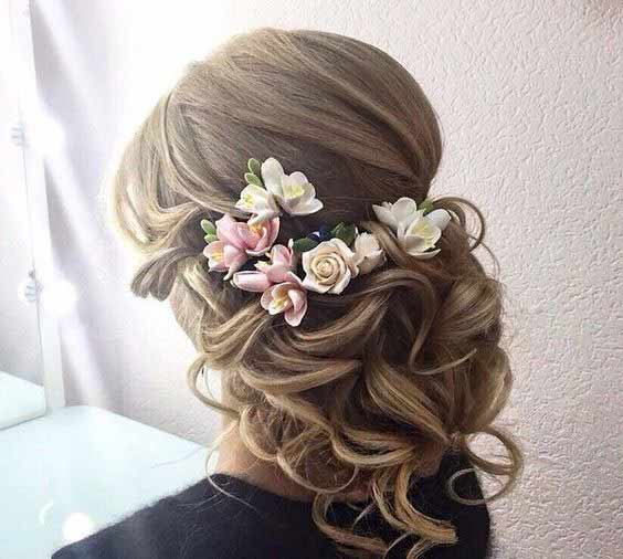 Flower adorned hair bun for engagement brides