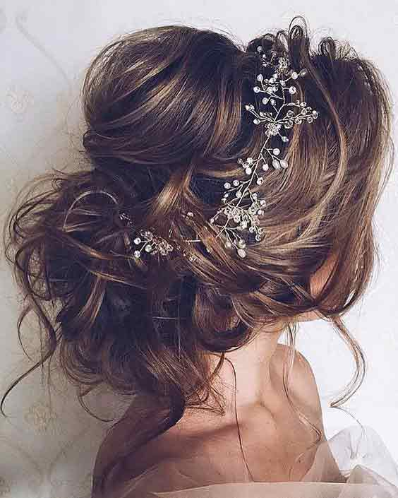 Low bun with a bump hairstyle for brides
