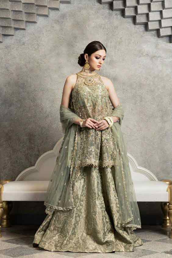 Pakistani green peplum dress with lehenga for wedding brides
