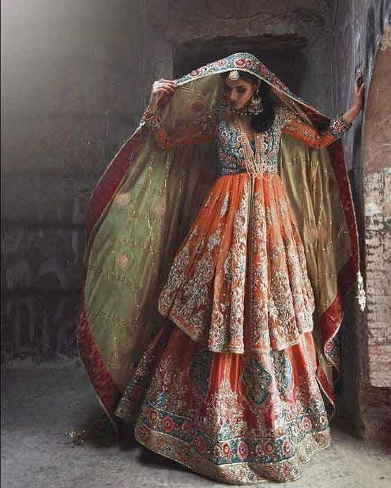 Orange peplum frock with lehenga and dupatta for Pakistani wedding brides