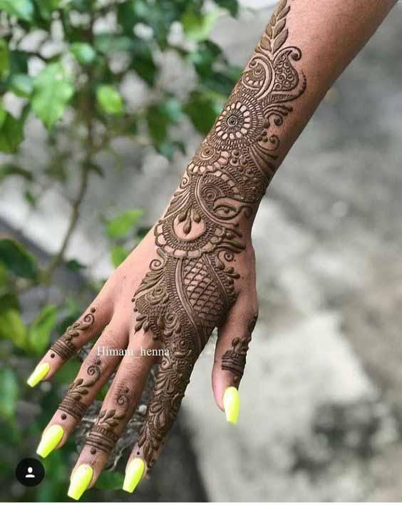 Pakistani bridal back hand and arm mehndi designs