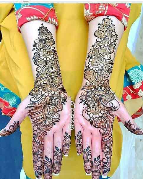 Side booti front hand mehndi ideas for brides