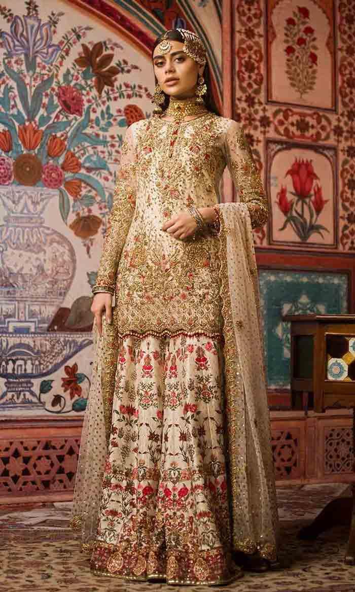 Pakistani bridal off-white kurti with lehenga