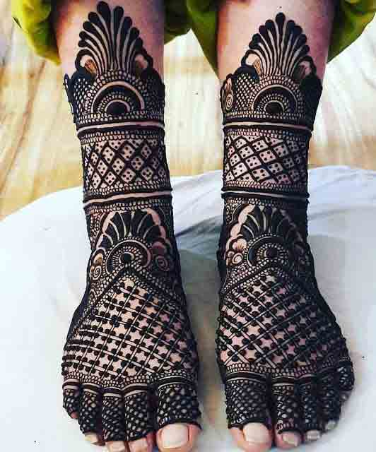 Dark full mehndi style for foot and legs